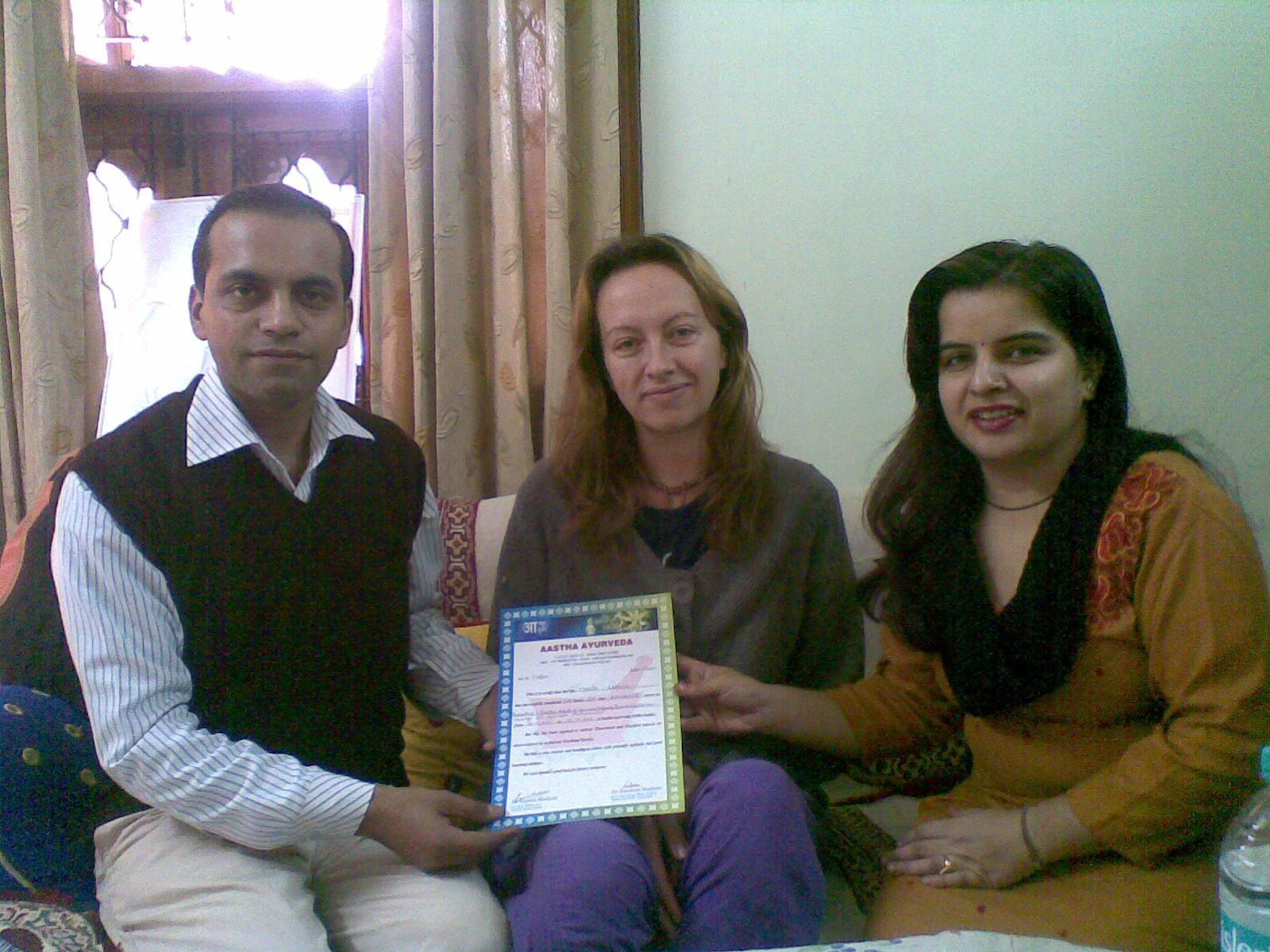 Spanish student Maria ,being issued a certificate for completion of Ayurveda Course